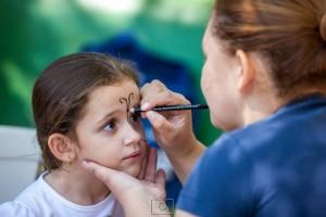 Pintura facial é uma das atividades. Imagem: Divulgação Foto Clube Pouso Alegre